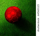 Red soccer football on grass field - stock photo