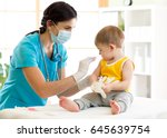 doctor pediatric holds an... | Shutterstock . vector #645639754