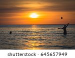 people playing in the sea with... | Shutterstock . vector #645657949