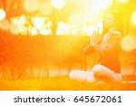 yoga woman meditating on green... | Shutterstock . vector #645672061