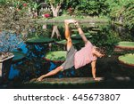 young man practicing yoga... | Shutterstock . vector #645673807