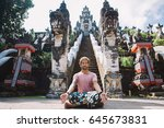 young man practicing yoga... | Shutterstock . vector #645673831