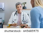 senior female doctor listening... | Shutterstock . vector #645685975