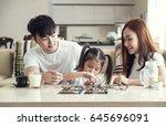 asian family teach asian cute... | Shutterstock . vector #645696091