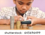 hands boy holding coin and... | Shutterstock . vector #645696499