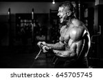strong athletic men pumping up... | Shutterstock . vector #645705745