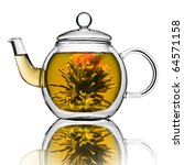 A Glass Tea Pot With Flower...