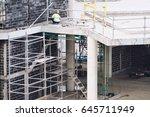 worker building in the... | Shutterstock . vector #645711949