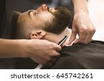 professional barber doing a... | Shutterstock . vector #645742261