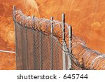 chain link fence with razor... | Shutterstock . vector #645744