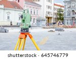 Small photo of Surveyors ensure precise measurements before undertaking large construction projects.