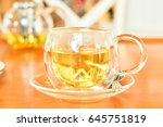 a cup of hot organic tea on the ... | Shutterstock . vector #645751819