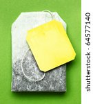 close up of tea bag on green... | Shutterstock . vector #64577140
