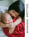 little sister hugging her... | Shutterstock . vector #645777151
