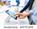 customer choosing a new mobile... | Shutterstock . vector #645791695