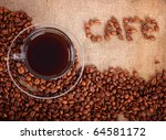 cup of coffee on the canvas with coffee beans - stock photo