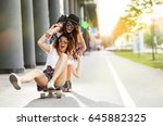 two female friends playing with ... | Shutterstock . vector #645882325