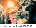 barista making coffee grinding... | Shutterstock . vector #645883939