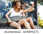 two female skaters friends... | Shutterstock . vector #645894271