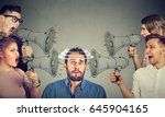 group of people screaming in... | Shutterstock . vector #645904165
