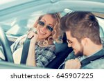 young man and woman smiling... | Shutterstock . vector #645907225