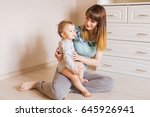 happy mother with adorable baby ... | Shutterstock . vector #645926941