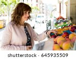 attractive middle aged woman... | Shutterstock . vector #645935509