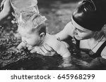 young mother  happy little girl ... | Shutterstock . vector #645968299