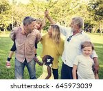 family walking field nature... | Shutterstock . vector #645973039