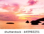 setting into the sea burning... | Shutterstock . vector #645983251