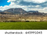 farm in mountainous countryside.... | Shutterstock . vector #645991045