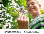 teen boy with a fidget spinner... | Shutterstock . vector #646003867