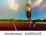 sporty woman running on stadium ... | Shutterstock . vector #646006105
