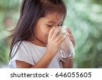 cute asian little girl drinking ... | Shutterstock . vector #646055605