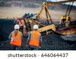 coal mine workers in an open pit | Shutterstock . vector #646064437