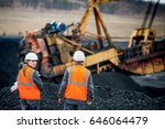 coal mine workers in an open pit | Shutterstock . vector #646064479