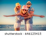 happy family on the beach.... | Shutterstock . vector #646125415