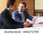 closeup of two smiling business ... | Shutterstock . vector #646171705
