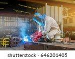 worker welding construction... | Shutterstock . vector #646201405