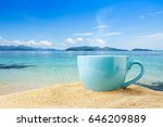 blue cup of coffee on tropical... | Shutterstock . vector #646209889