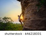 man climbing on the rock at... | Shutterstock . vector #646218331