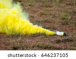 Small photo of songkla, thailand – January 9, 2016: cracker blast yellow smoke filled come out around area on little green grass lawn dry look colorful picture