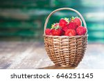 strawberries in a woven basket | Shutterstock . vector #646251145