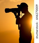 man photographer with a camera... | Shutterstock . vector #646270009