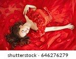 girl in red dress among red...   Shutterstock . vector #646276279