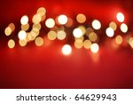 Abstract blurred white lights on red background - stock photo
