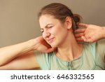 Small photo of Aches and pains concept. Woman having bad ache and pain. Female placing hands on her neck.