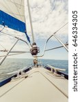 Small photo of Lapper genoa roller jib, jibsheet on boat during cruise on sea water, sunny day.