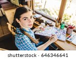 beautiful young painter in her... | Shutterstock . vector #646346641