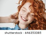 close up of beautiful redhead... | Shutterstock . vector #646353385